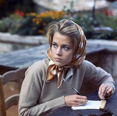 """Jane Fonda taking notes during a break in filming at Auberge de la Colombe d'Or in Saint-Paul-de-Vence, photo by Francois Pages, Sept. 1963 """""""