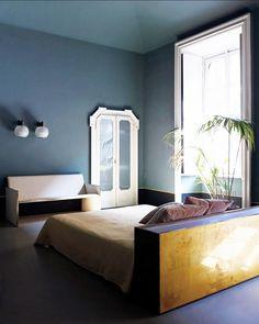 Minimalist bedroom with indoor plant and navy walls // Italian design