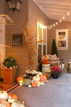 Cozy and natural fall porch decorating ideas. Create a welcoming front porch using pumpkins cornstalks and candles. Cozy and natural fall porch decorating ideas. Create a welcoming front porch using pumpkins cornstalks and candles. Thanksgiving Decorations, Seasonal Decor, Holiday Decor, Autumn Decorations, Diy Thanksgiving, Holiday Lights, Outdoor Decorations, House Decorations, Autumn Nature