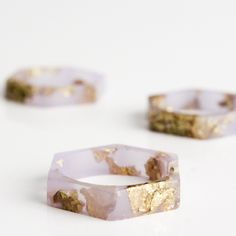 Eco resin jewelry, bangles and rings in a rainbow of colours featuring metallic leaf flakes as well as beautifully preserved natural and