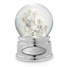 """Personalized Butterfly Snow Globe Gift by Things Remembered. $34.99. Butterflies are a symbol of a long life and of bliss, making this just the right gift for a close friend, a mother, or anyone you wish a long, happy life. The silver-plated butterflies are accented with light pink crystals. This unique, whimsical gift will be cherished, especially once engraved.- This water globe is musical! It plays """"Santa Lucia.""""- Perfect for a birthday, Mother's Day or Valentine's Day..."""