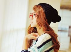 I love her hat, glasses, and sweater! Her hair is pretty awesome too. haha