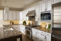 Old world Italian meets contemporary lines in this kitchen, featuring top of the line appliances and fixtures. Birmingham, Custom Kitchens, Old World, My Design, Appliances, Kitchen Cabinets, Contemporary, Santa Barbara, Michigan