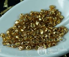 "24K Filled Gold Plated Czech Glass Pinch Beads Spacer 3mm (0.12"") 20pcsColor: Gold Size (mm): 5mm (0.20"") x 3mm (0.12"") Shape: Oval/Cross Sold in packs of 20pcs..."