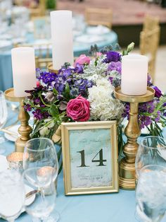 Bring an allover glow to your reception space with these 18 romantic candle centerpieces.