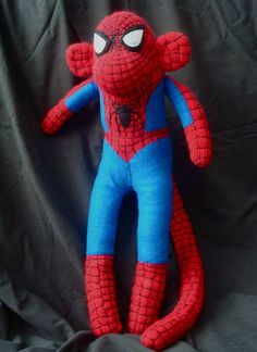 Craftster user SeeMellySew created this Spiderman-inspired sock monkey for a friend of her husband's--came out great, no? The webbing work is amazing! Rela