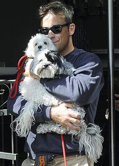 ROBBIE WILLIAMS  AND ONE OF HIS DOGS