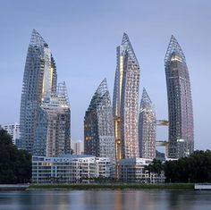 Architect Daniel Libeskindhas completed a family of curved towers beside a bay in Singapore.