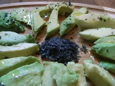 sliced avocado with black lava salt and olive oil-Black lava salt has an unforgettable aroma and important health benefits from the charcoal in lava. Its striking colour and great smoky notes make it a great finishing salt for any dish. Great on salads, vegetables. Exceptional on Sushi, grilled steak, teriyaki chicken or tofu