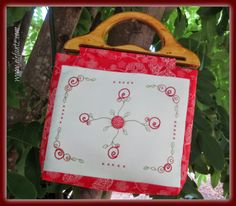 Four pockets and a simple embroidered front panel! The perfect bag to carry your stitching in...