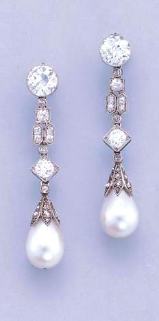 A PAIR OF ART DECO PEARL AND DIAMOND PENDANT EARRINGS  Each composed of a drop-shaped pearl measuring 9.90 - 9.98 x 13.62 mm. and 10.02 - 10.03 x 14.20 mm. respectively with rose-cut diamond cap to the geometric diamond-set line suspended from an old-cut diamond collet, millegrain setting, circa 1920, diamond-set caps earlier, in brown leather fitted case