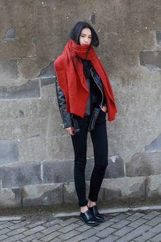 Black skinny jeans, black leather biker jacket and large dark orange scarf. #skinny-jeans #scarf