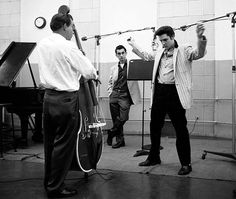 """Uncropped picture from the Jailhouse Rock recording sessions.In the back is George Klein watching Evis. Bill Black on bass. 