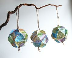 I love these ornaments made from old atlases!  We used to make similar ornaments when we were kids!