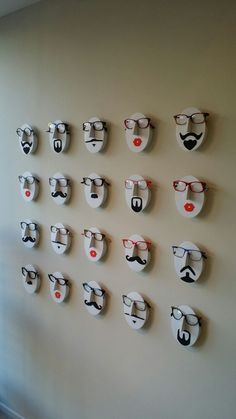 Our wall of faces displaying our Face á Face spectacles.