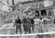 THE BOSNIAN CIVIL WAR 1992 - 1995  Bosnian Muslim civilians cross a temporary foot bridge replacing the famous 16th century Stari Most Bridge at Mostar, shortly after it was destroyed by Croat tank fire in 1994.