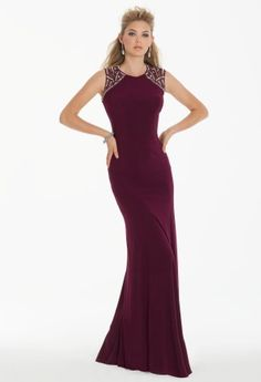 Cachet jersey high neck dress with beaded cap sleeves and open clover cut out back.<br><br>• Scoop neckline<br>• Beaded cap sleeves<br>• Fitted bodice and empire waist<br>• Trumpet skirt<br>• Patterned open back and center zipper