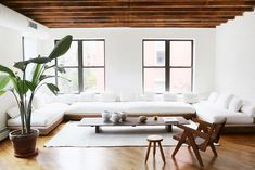 We're all about a whitewashed living room with clean, crisp white upholstery that pops off a warm neutral base. From the rustic wood beams and floors to the oversize built-in sofa you can only dream of sinking into, the chic simplicity of a color story that consists of shades of brown and white lets the design details speak for themselves.