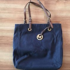Michael Kors navy slim shoulder bag This is my favorite bag for carrying my laptop and papers because it is the perfect size to carry these things. Still in excellent condition. MICHAEL Michael Kors Bags Totes