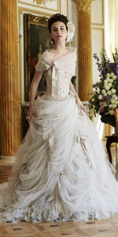 The shawl and draping of the skirt would make a great steampunk outfit with different colors and patterns...