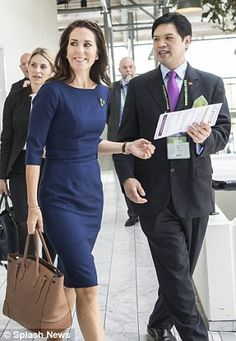 Arm candy: Looking as stylish as ever, the 44-year-old Royal paired the frock with her beloved Ralph Lauren Ricky handbag