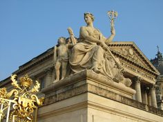 Versailles, France - Statues at the entrance of the Versailles Palace