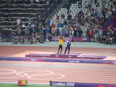 Saturday 11th August. Olympic Stadium. Mo & Bolt the two track stars of 2012 celebrate gold medals