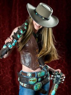 ~ Rock n' Roll Cowgirl! Brit West wearing 3 tiers of her leather belts adorned in turquoise around her waist. A fab way to wear them while displaying her leather & turquoise cuffs on her shoulder. Am I reaching. Sexy Cowgirl, Cowgirl Hats, Cowgirl Chic, Western Chic, Western Hats, Cowgirl Outfits, Cowgirl Style, Western Outfits, Western Wear