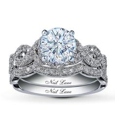 Neil Lane Bridal® 7/8 Ct. tw 2-Piece Diamond Bridal Setting    Reminiscent of Hollywood's most glamorous era, designs by Neil Lane are as contemporary as they are nostalgic. Here, a place is held for the diamond of your choice, encircled by round diamonds, as additional round diamonds weave a pattern to accentuate the center. The matching wedding band hosts a line of round diamonds.