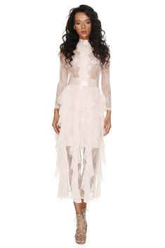 A captivating party-appropriate Vero Milano long translucent lace dress with lavish ruffles giving a veiled glimpse of skin. White Outfits, Summer Outfits, Lace Skirt, Lace Dress, Lace Party Dresses, Romantic Outfit, Festival Outfits, White Lace, Dresses Online