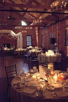 indoor wedding venue with brick and wood