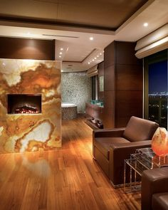back lit Onyx stone fireplace Miami Beach Apartment by Pepe Calderin Design