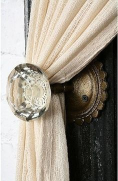 Love this old door knob as a curtain drawback!
