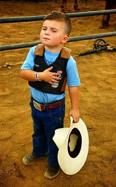 A 3 year old today during the National Anthem before his rodeo. He finished 3rd out of twenty-five contestants in the Mutton Bustin' Competition.