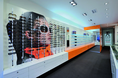 """Kaasschieter Brillen in The Netherlands, designed by WSB Interieurbouw, fitted with Top Vision's """"Mino"""" columns."""