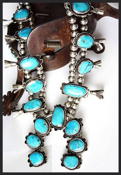 Vibrant turquoise and Sterling silver  squash blossom necklace