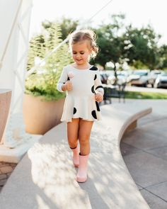Those pink polka-dotted rain boots!