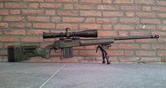 Remington 700 / McMillan /Schmidt & Bender. Like the barrel length, not a fan of the break.