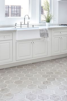light-colored hexagon tiles in the kitchen with lighter colored grout. Grey Kitchen Floor, Kitchen Redo, Kitchen Remodel, Kitchen White, Grey Tile Floor Kitchen, Best Kitchen Flooring, Kitchen With Tile Floor, Hexagon Floor Tile, Entryway Tile Floor