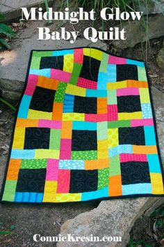 Midnight Glow baby quilt tutorial is fast and easy to make using fat quarters or quilt fabric bundles. There are 3 different sizes of blocks. Lap Quilts, Scrappy Quilts, Small Quilts, Quilt Blocks, Bright Quilts, Patchwork Quilting, Baby Quilt Tutorials, Quilting Tutorials, Quilting Projects
