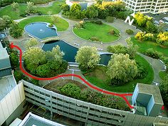 What is called an intensive green roof - heavy planting. And this sports a waterfeature too. We need to start designing our surroundings for life and people, not cars.