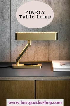 A heavyweight with elegance and grace. Striking from every angle. Crafted from solid machined brass with bronze arm insert. A curved metal shade features a slotted grill on either side with opal diffusers ensuring soft, warm light. Practical pen tray machined into the base. Cool Lighting, Table Lighting, Desk Lamp, Table Lamp, Kitchen Lamps, Light Table, Living Room Bedroom, Home Furnishings, Bulb