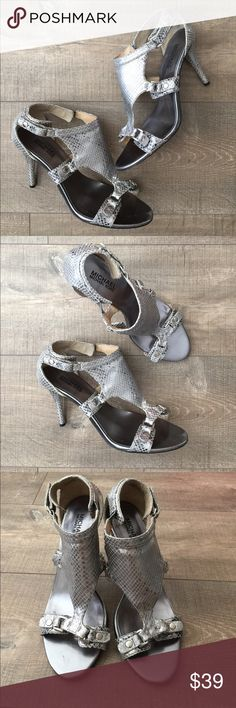 Michael Michael Kors silver leather & metal heels Gently worn , size 8.5 , leather n metal accents , heel is approx 4 inches , adjustable snap closure MICHAEL Michael Kors Shoes Heels