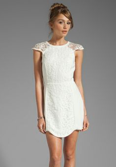 Cameo Into the Flame Dress in Ivory. I think I like this one... what do you think? I feel like it needs something for the waist...