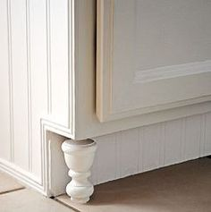 DIY cabinet feet from curtain finials! You've got to check this out, simple little curtain rod wood finials, cut to measured length and the cabinets take on at least another several thousand dollars worth of classy looks. New Kitchen Cabinets, Diy Cabinets, Kitchen Redo, Kitchen And Bath, Kitchen Ideas, Ranch Kitchen, Kitchen Designs, Kitchen Makeovers, Kitchen Island