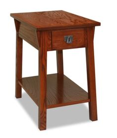 """Leick Mission Chair Side End Table, Russet Narrow design perfect for small living spaces Constructed of solid ash wood with a hand applied multi-step russet finish Solid wood drawer and guides, Classic mission style with canted post/wedge corbel design Stylish blackened metal drawer pulls and bottom shelf for storing magazines Easy assembly, Dimensions:15""""W x 24""""D x 24""""H  $125"""