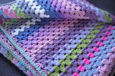 After stalling with granny squares , my first large crochet project is of the stripey variety. I find the stripes more satisfying as you c...