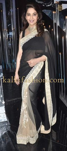 http://www.kalkifashion.com/ Madhuri Dixit Nene in a black and beige saree by Sabyasachi on the set of Jhalak Dikhla Jaa.