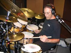 Vinnie Colaiuta has played with everyone under the sun. He has played with Frank Zappa, Sting and Eric Clapton. He is one talented drummer.