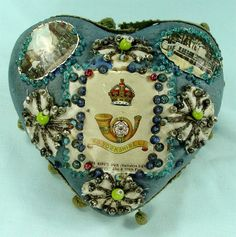 WW1 Sweetheart Pincushion with King's Own Yorkshire Light Infantry badge.